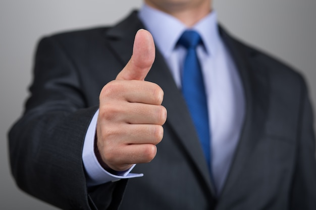 Close up of business man hand with thumb up. approval positive gesture
