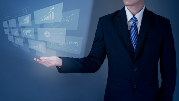 Close up business man is holding digital virtual screen, analytics financial data
