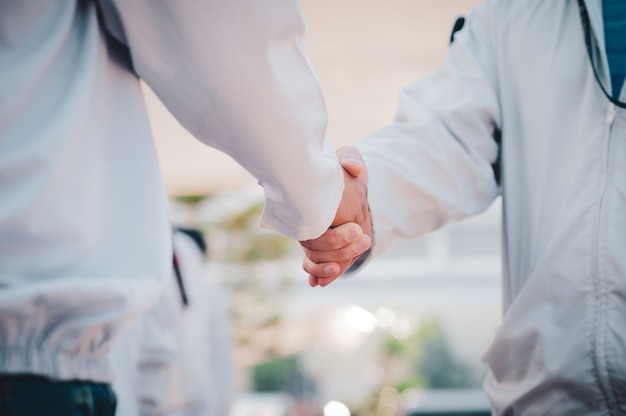 Close up business people shake hand