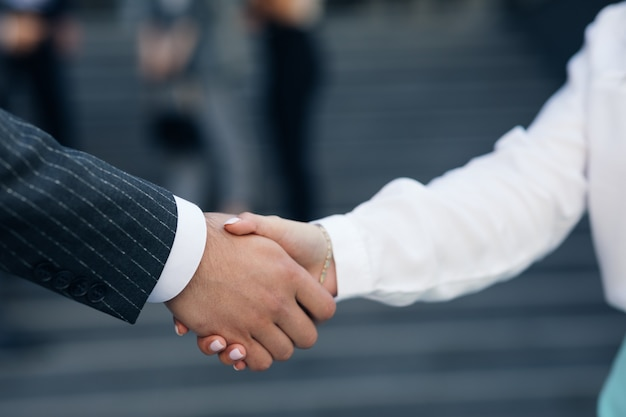 Close up business people shaking hands corporate partnership deal welcoming opportunity for cooperation. handshake of two people. successful deal concept.