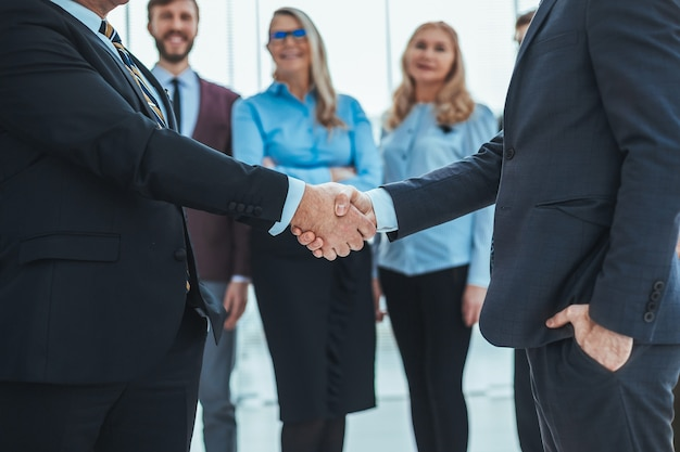 Close up. business people shaking hands with each other. concept of partnership