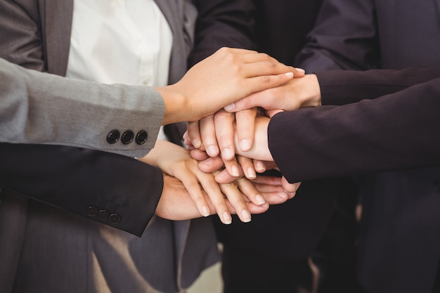Close-up of business people stacking hands