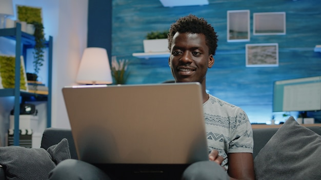Close up of business person using laptop for remote work