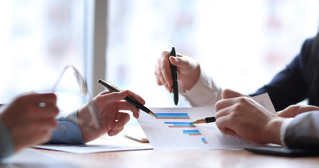 Close up. the business team analyzes the financial data.business concept