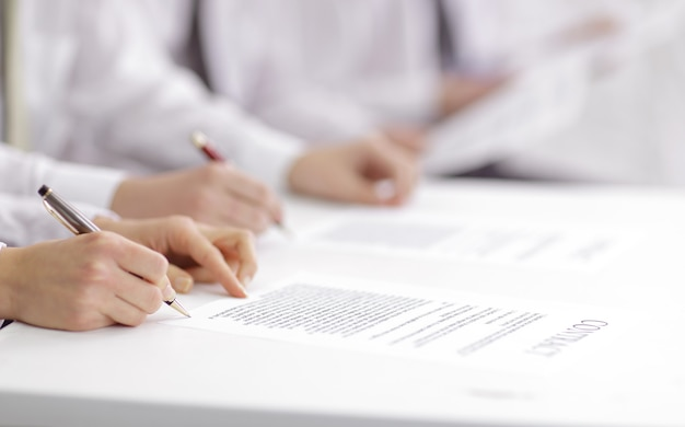 Close up. business team studying the terms of the contract.photo with copy space