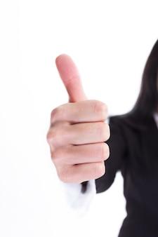 확대. 엄지손가락을 보여주는 비즈니스 우먼