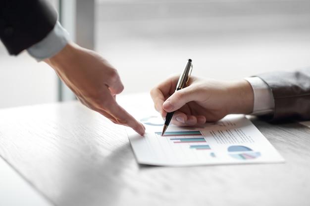 Close up.the businessman checks the financial data