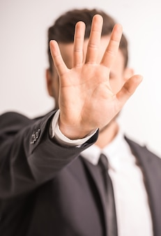 Close-up of businessman hand in focus on grey.