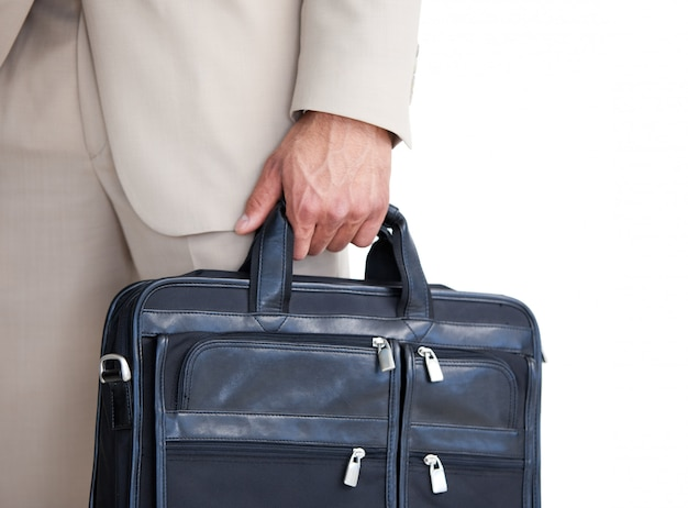 Close up of a businessman holding a briefcase