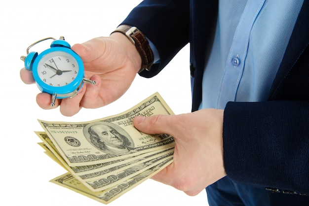 Close up of businessman holding a clock and one stack of cash in hand