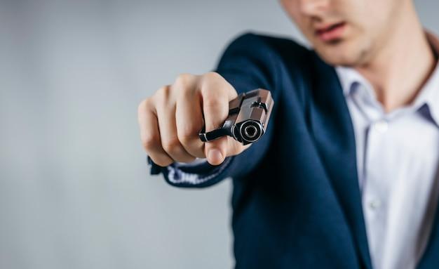 Close up of businessman holding a gun