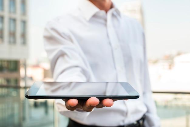 Close-up businessman holding tablet