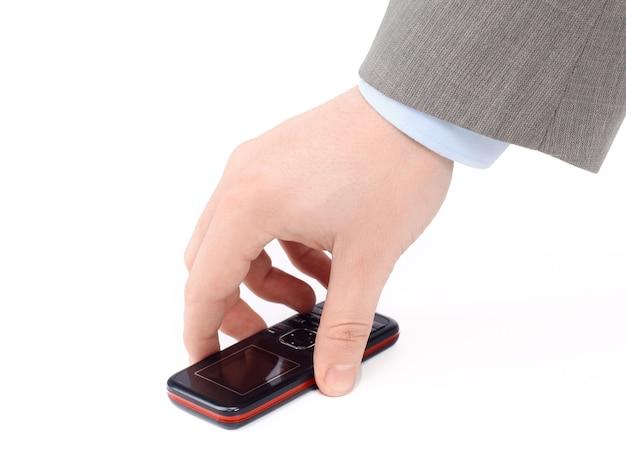 Закройте вверх. бизнесмен поднимает мобильный телефон.