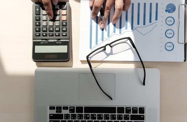 Close up businessman using calculator on  finance