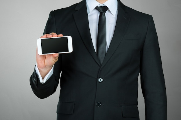 Close up of a businessman using mobile smartphone