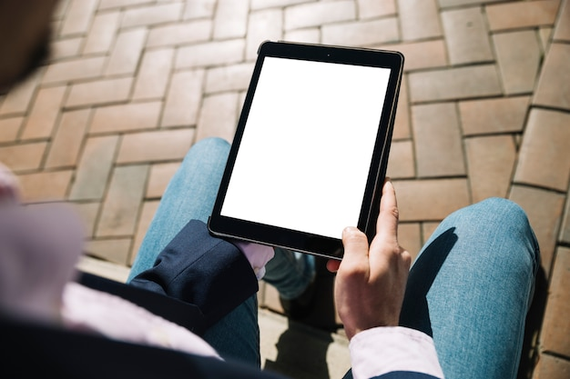 Close up of businessman using tablet outdoors