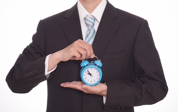 Close-up of businessman with a blue clock