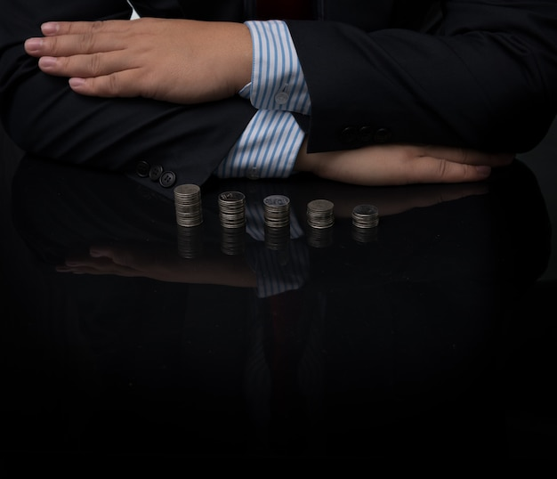 Close-up of businessman with coins