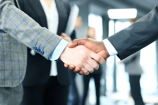 Close up of the businessmen shaking hands.