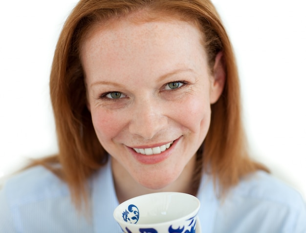 Close-up of a businesswoman drinking a cup of tea