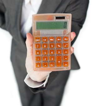 Close-up of a businesswoman holding a calculator