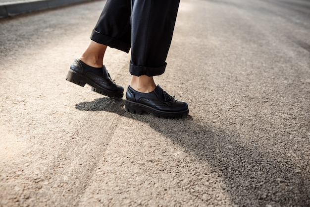 Close up of businesswoman's legs step.