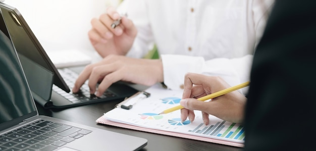 Close up businesswoman using checking a graph in the office