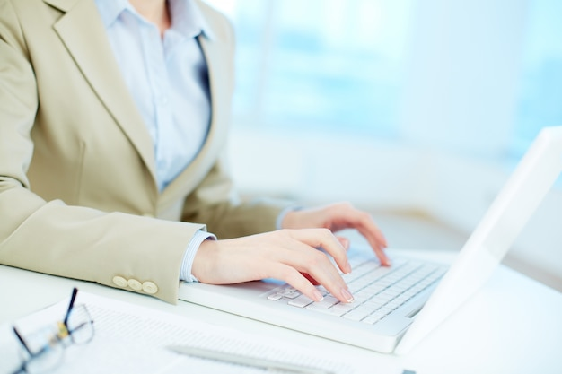 Close-up of businesswoman working online