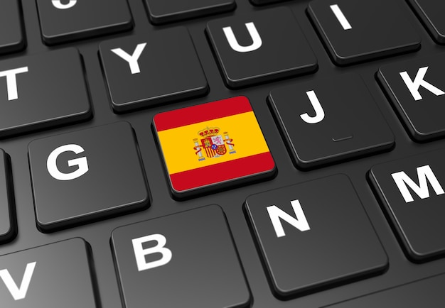 Close up of button with spain flag on black keyboard