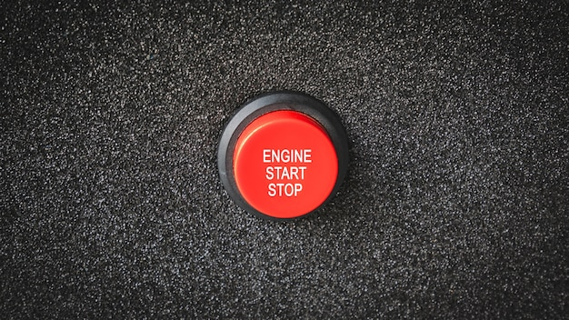 Close up on buttons with letters indicating starting the engine or electrical engine.