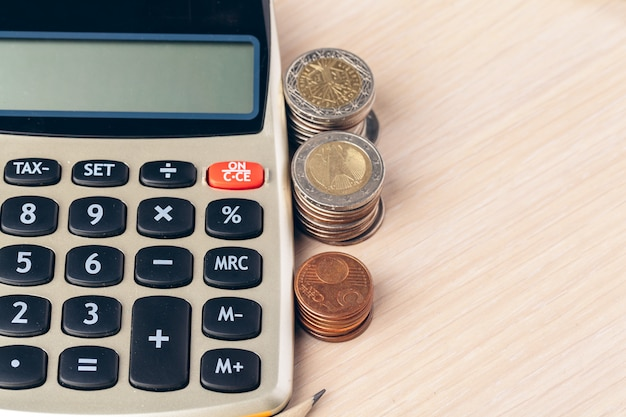 Close up of a calculator and coins on a business
