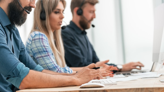 Close up. call center operators in the workplace. people and technology