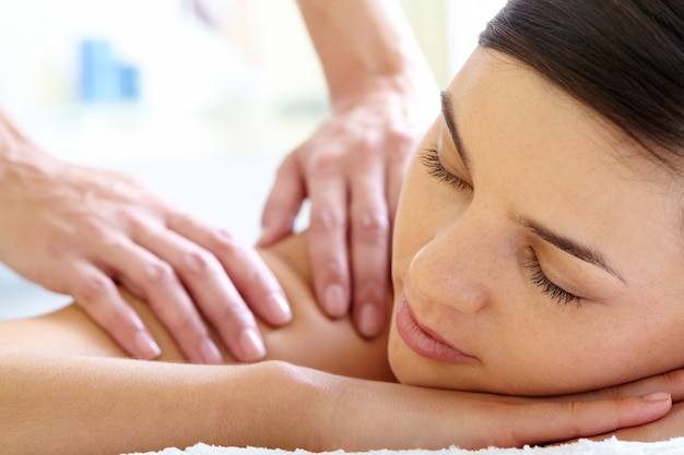 Close-up of calm woman getting a massage