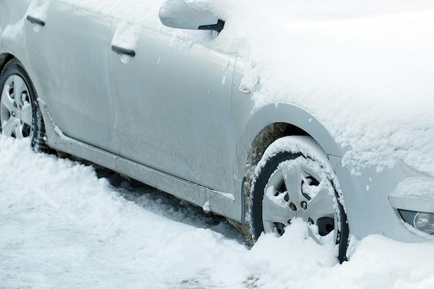 Close up on car after abundant snowfall