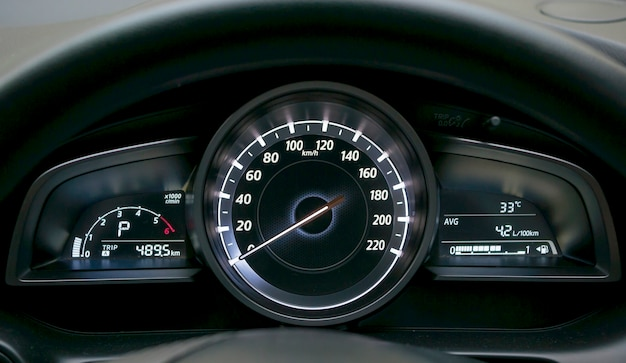 Close up of car dashboard and odometer.