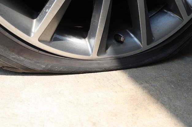 Close up on car flat tire