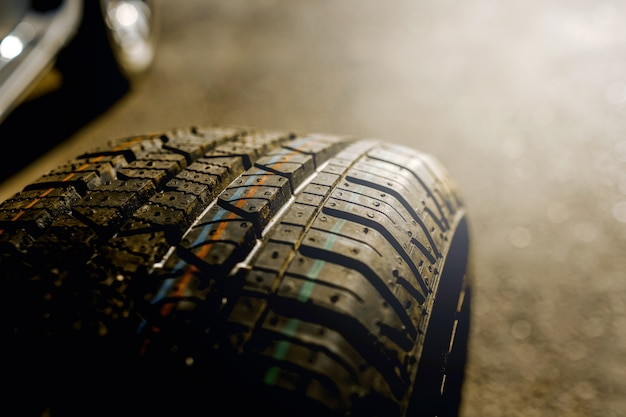 Close-up of a car tire. the driver should replace the old wheel with a spare