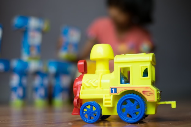 Close up car toy with children playing toys