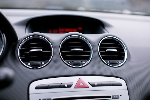 Close up car ventilation system and air conditioning in car