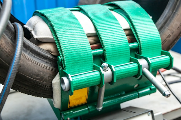 Close-up of a car wheel, a tire is standing on a balancing machine for balancing in an automobile workshop.