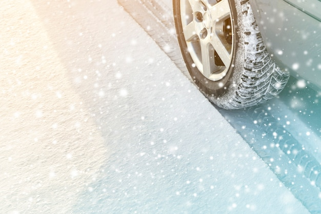 Close up of car wheels rubber tires in deep winter snow road