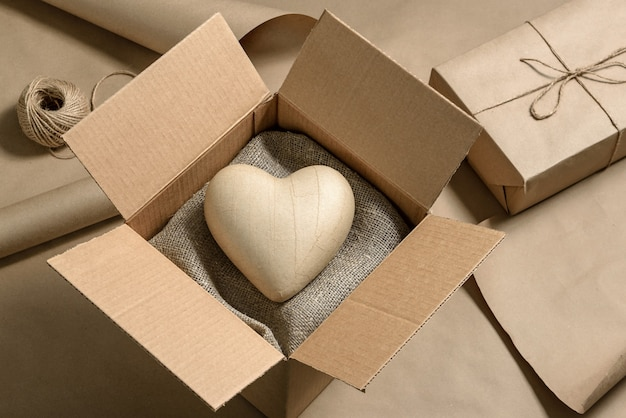 Close-up of a cardboard box with a paper heart inside. valentine's day gift concept.