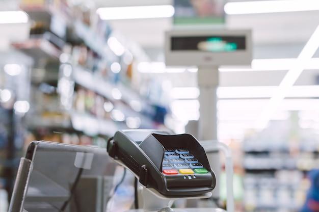 Close up on cash machine in supermarket