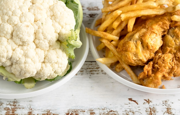 Close-up of cauliflower and fried food on table