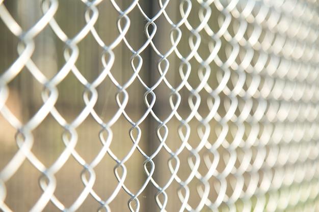 Close up chain fence. metal mesh .  white tone