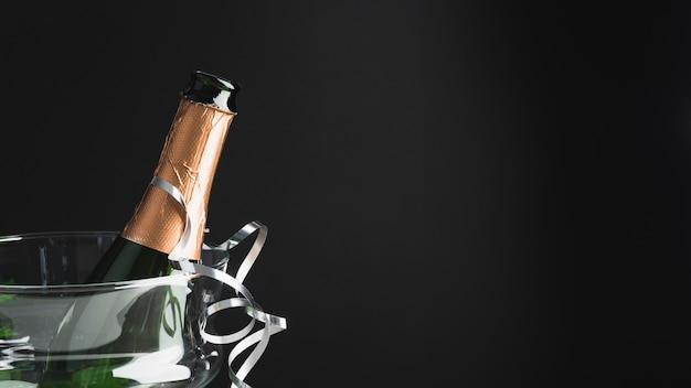 Close-up champagne bottle with copy space