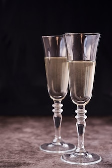 Close-up of champagne glass on concrete background