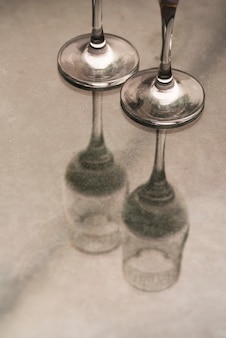 Close-up of champagne glasses on table