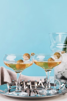 Close-up champagne glasses with olives