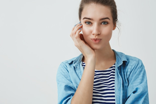 Close-up charming good-looking young mother taking skincare, smiling happy visiting beauty salon done nails, folding lips silly cute, touching cheek, having lucky fantastic day,